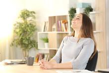 Woman Breathing Fresh Air Sitt...
