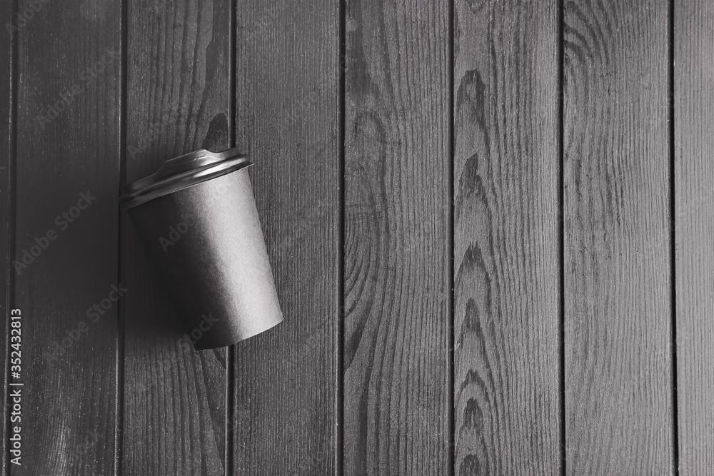 Fototapeta Blank cup on dark wooden background