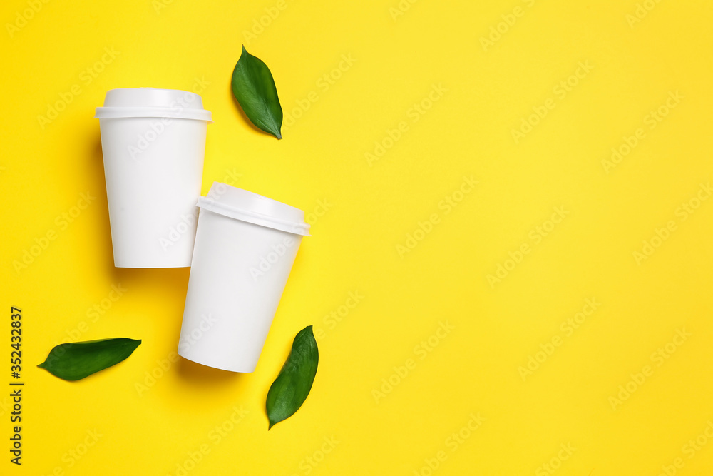 Fototapeta Takeaway cups for drink on color background
