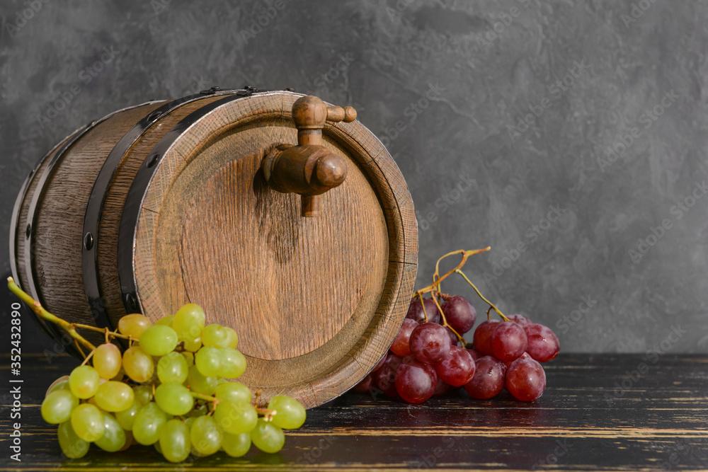 Fototapeta Wooden barrel of wine on table