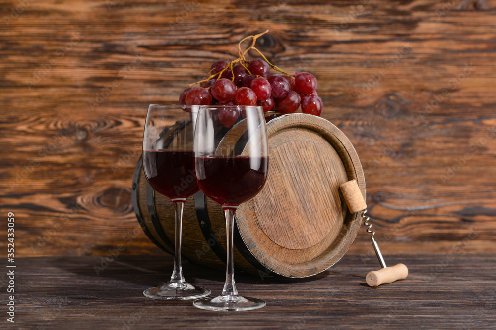 Fototapeta Wooden barrel and glasses of wine on table