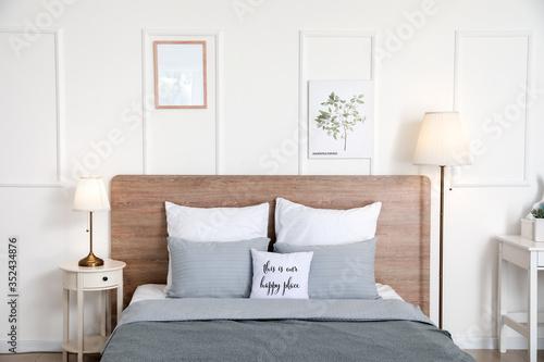 Fototapeta Stylish interior of bedroom with lamps obraz