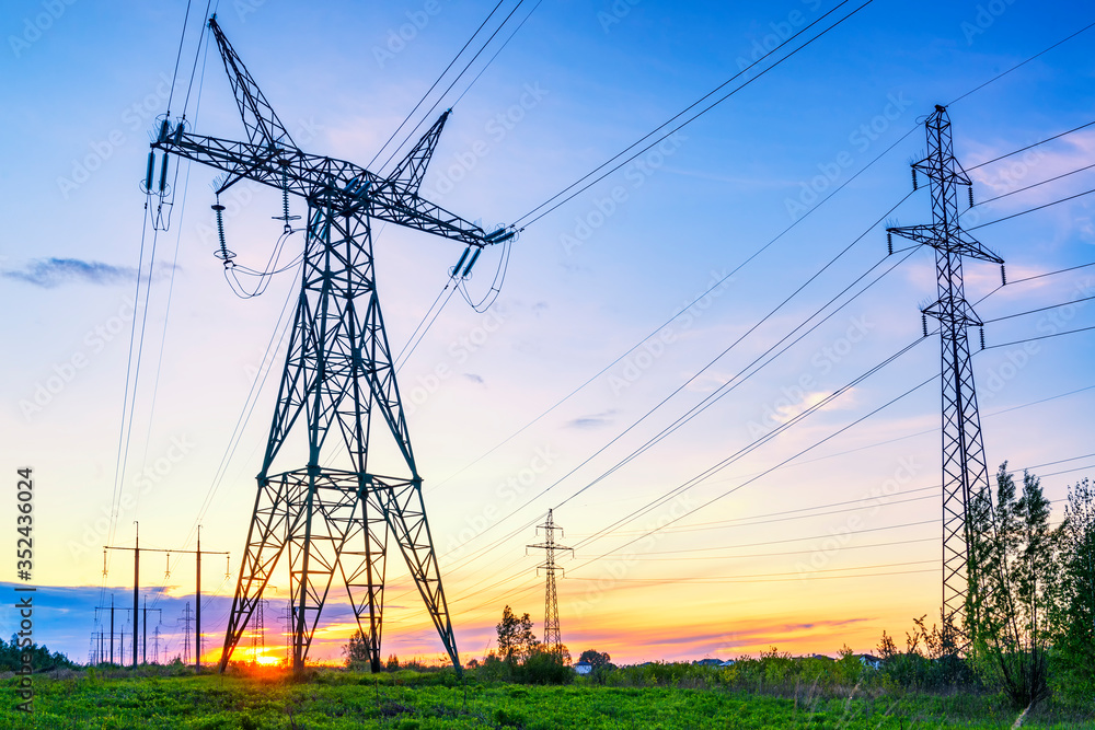 Fototapeta Industrial landscape with high voltage power lines