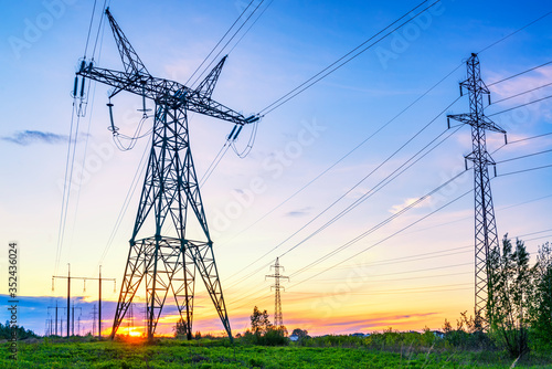 Fototapeta Industrial landscape with high voltage power lines obraz