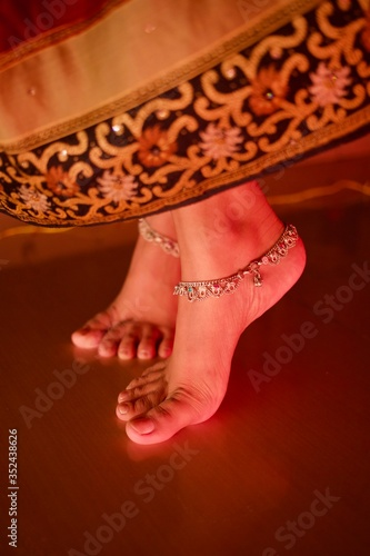 Low Section Of Woman Wearing Anklets On Floor Canvas Print