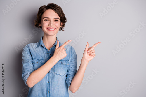Obraz Portrait of positive cheerful girl promoter follow indicate present ads promo wear good look outfit isolated over gray color background - fototapety do salonu