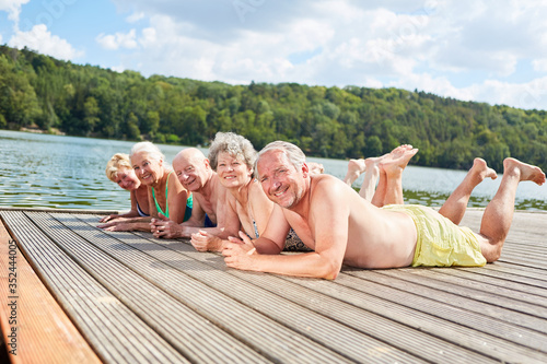 Obraz Retired seniors relax at the lake - fototapety do salonu