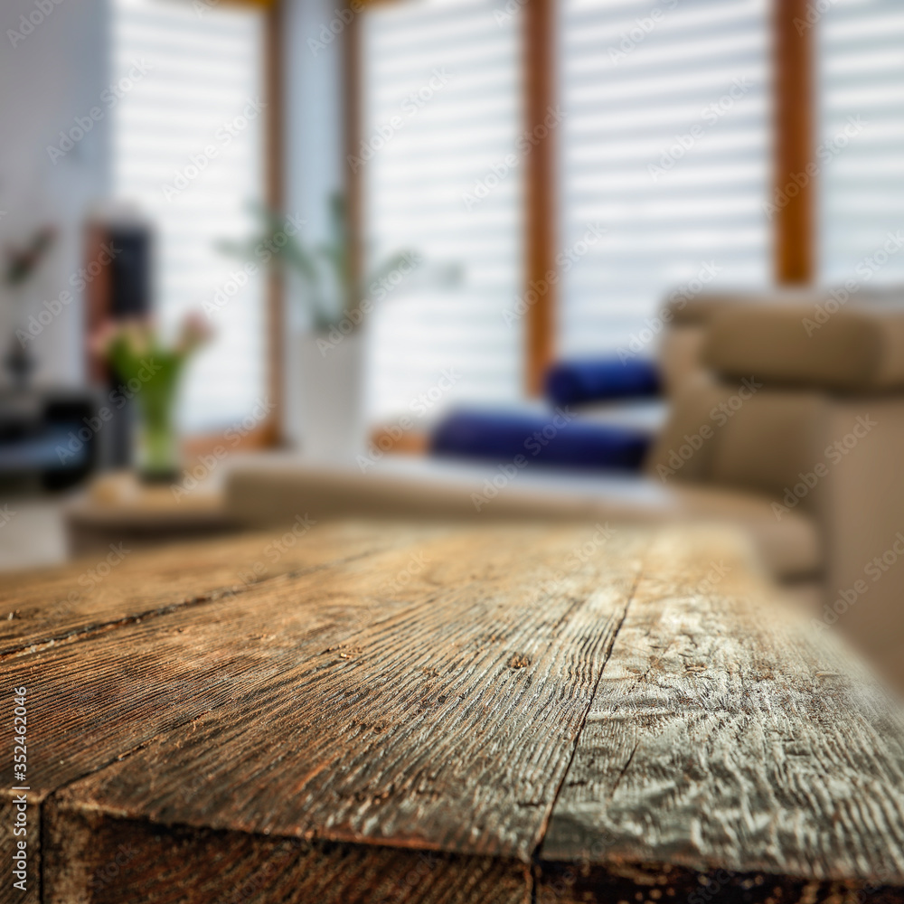 Fototapeta Wooden table in the living room on a beautiful holiday day with a great mood