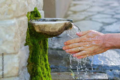 Washing hands in fresh, cold, potable source water on a mountain, Drinking Sprin Tapéta, Fotótapéta