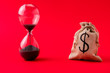 canvas print picture - Close-up view of moneybag account market management stocks shares rate running out of time sand clock counting isolated over bright vivid shine vibrant red color background