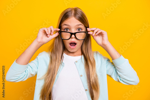 Obraz Photo of beautiful pretty little blond lady diligent student pupil take off glasses open mouth see bad grade mark year wear specs casual shirt isolated yellow bright color background - fototapety do salonu