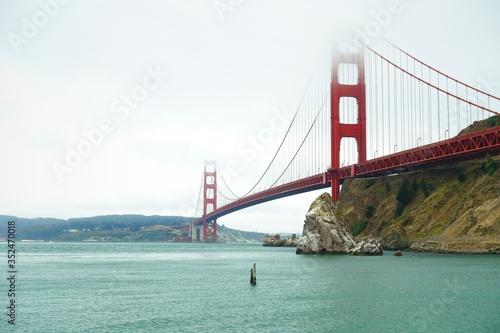 Obraz View Of Suspension Bridge Over Sea - fototapety do salonu