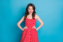 Photo Of Stunning Attractive Pretty Curly Lady Bright Shiny Pomade Smiling White Teeth Good Mood Arms By Sides Wear Red Dotted Retro Dress Isolated Blue Color Background