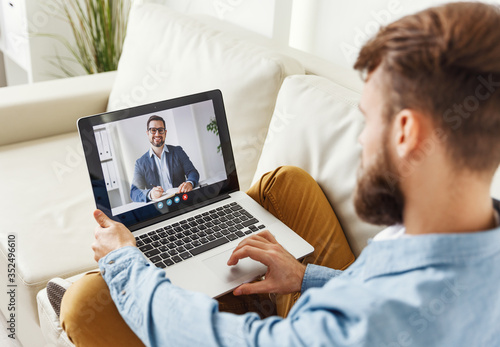 Obraz Man speaking with online financial counselor. - fototapety do salonu
