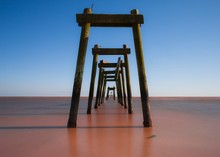 Old Pier On Sea Against Clear Sky