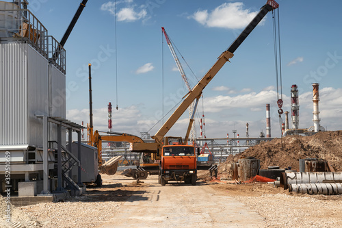 Construction site of an oil refinery with a large number of construction equipme Wallpaper Mural