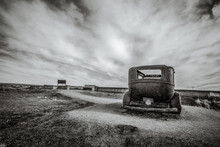 Abandoned Vintage Car Rusting In The Desert Of The American Southwest.