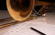 Pencil, Sheet Music And Trombone