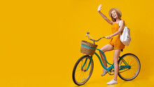 Hello, Summer. Positive Young Girl Riding Vintage Bicycle And Waving Hand