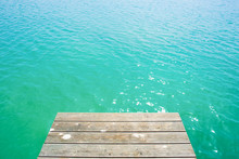 Summer Background, Wooden Footbridge On Swimming Lake With Turquoise Water