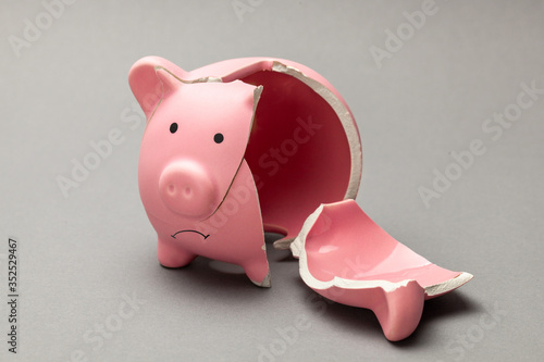 Broken piggy bank on gray background Fototapete