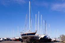 Rows Of Sailboats In Dry Dock Seen During A Sunny Spring Morning In The St-Laurent Village Marina Next To The St. Lawrence River, Island Of Orleans, Quebec, Canada