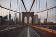 Suspension Bridge In City Against Sky During Sunset