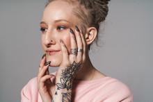Image Of Extraordinary Girl With Tattoo And Piercing Touching Her Face