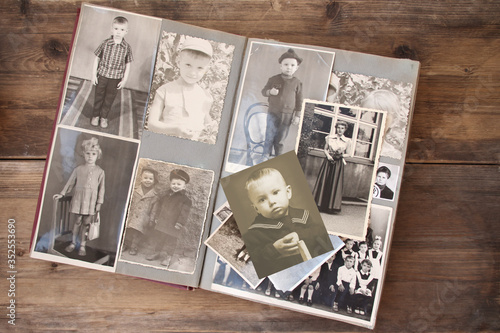 Photo old retro album with vintage monochrome photographs in sepia color, the concept