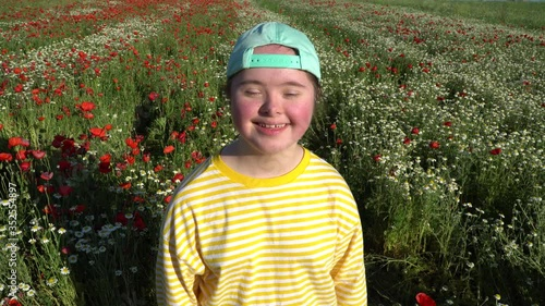 Fotografie, Obraz Girl on background of the flowers field