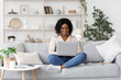 canvas print picture - Remote Work. Millennial african american woman working on laptop at home
