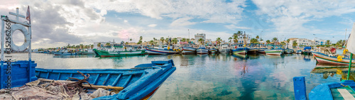 Canvastavla Panoramic View Of Boats Moored In Harbor Against Cloudy Sky