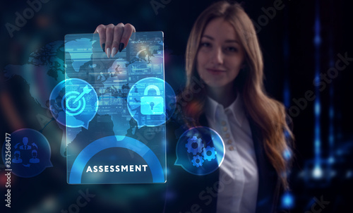 Obraz Business, Technology, Internet and network concept. Young businessman working on a virtual screen of the future and sees the inscription: Assessment - fototapety do salonu