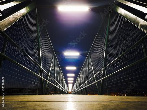 Surface Level View Of Illuminated Bridge At Night