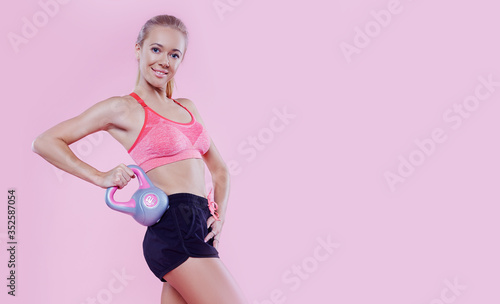 Cuadros en Lienzo Sexy sporty lady with weight studio portrait on pink background, fitness sporty woman beautiful fit girl, weight loss