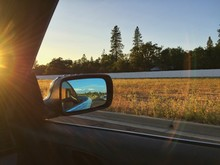 Reflection Of Road On Car Side-view Mirror During Sunny Day