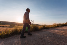 Older Man Taking A Walk In The Countryside. Day Laborer Returning Home. Selective Focus.