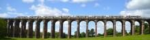 Panoramic View Of Train On Viaduct Bridge Against Sky