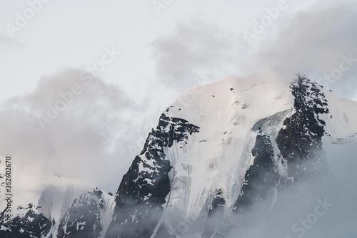 Atmospheric minimalist alpine landscape with massive hanging glacier on snowy mountain peak Wallpaper Mural