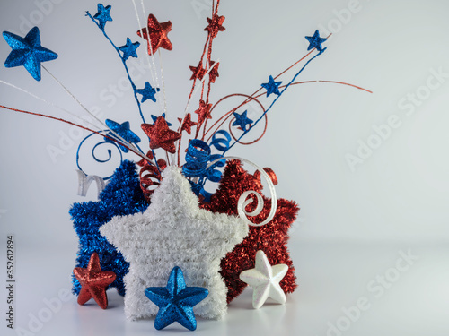 Red, white and blue tinsel stars with glitter stars in front and