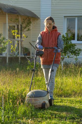 woman in backyard mowing grass lawn mower #352623471