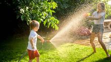 Litle Boy Having Water Fight O...