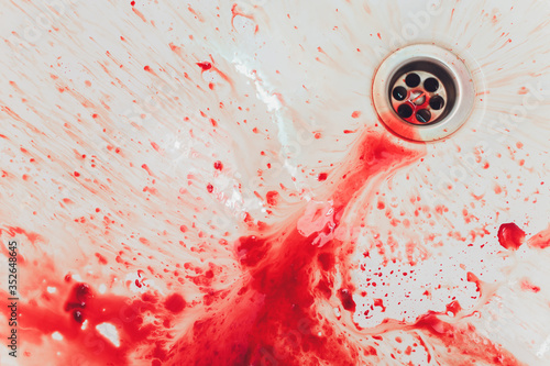 Cuadros en Lienzo Fresh red blood splat on white porcelain with specks from the impact