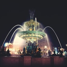 Illuminated Fountain Against Sky At Night