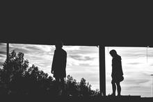 Silhouette Of People Under Bridge