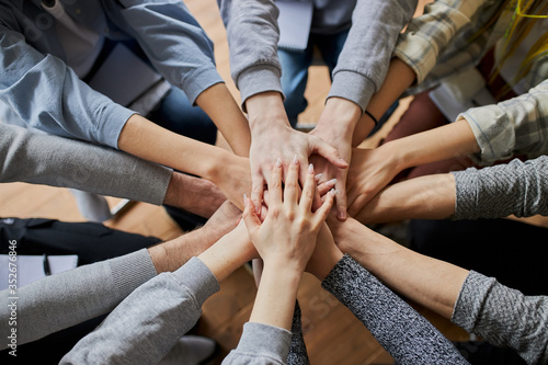 Fototapeta cropped photo of unrecognizable people hands gathered in one. anonymous alcoholics club team, fight with alcohol addiction obraz