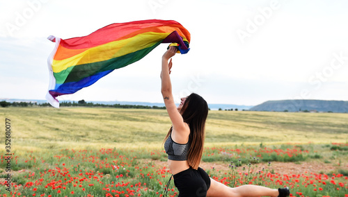 a beautiful girl with the pride flag on 2020 Wallpaper Mural