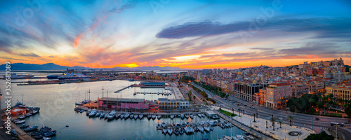 Panoramic view of Cagliari city and harbor at sunset. Aerial panoramic view of Casteddu.