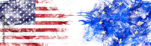 Obraz American and European flag in smoke on white background. Concept of conflict and customs duty. America VS Europe metaphor. Dollar Euro exchange currency and international commercial tension and crisis - fototapety do salonu