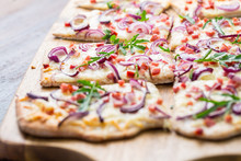 Flammkuchen - Traditional French Dish Tarte Flambee Cream Cheese, Bacon And Onions